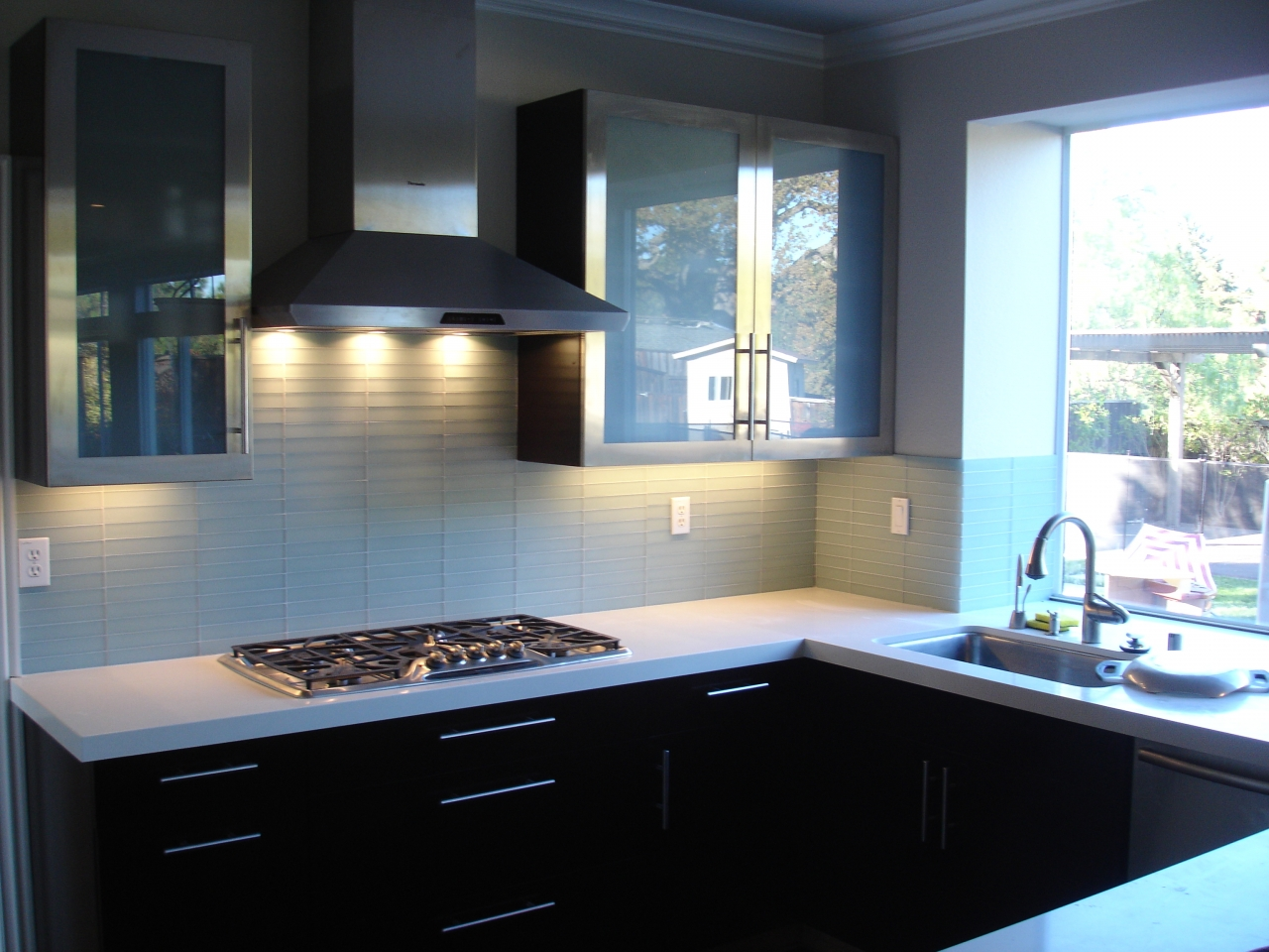 modern kitchen remodel with glass subway tile stainless metal glass cabinet doors